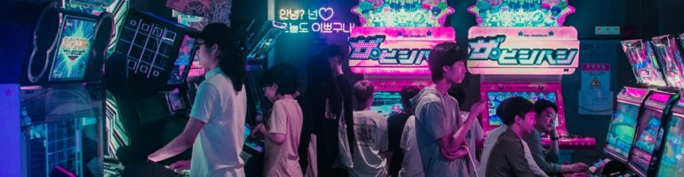 People playing in a korean arcade hall